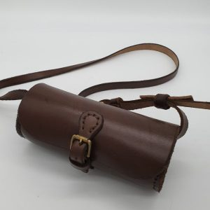 Brown, cylindrical leather shoulder bag, with brass buckles.