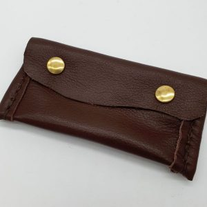 Soft, brown, rectangular leather purse. leather