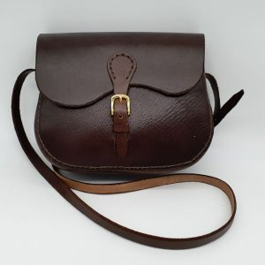 Brown, leather shoulder bag with brass buckles.